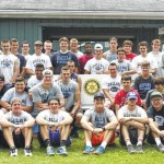 Dallas High School football players help set up for Dallas Rotary Wine & Dine Festival