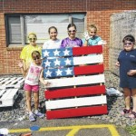 Members of Back Mountain Cadette Troop 32647 paint decorations at Dallas Elementary School