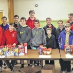 Scouts gather food for their neighbors in need