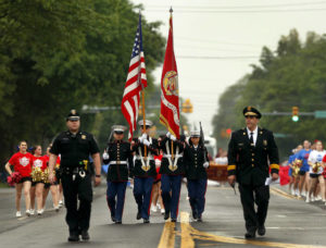 Rain doesn't keep crowd down at West Side Memorial Day Parade