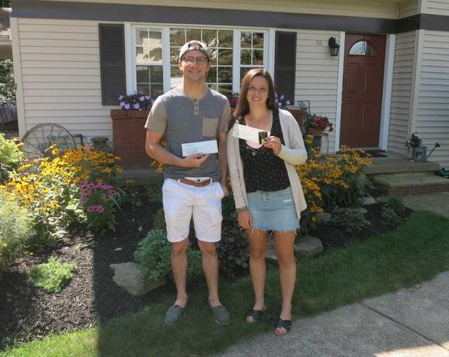 Dallas American Legion Post 672 presents checks to Joe and Mary Grace Ciaccia