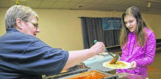 Diane Koonrad of Kingston serves spaghetti to Mary Ann Stout, 10 of Edwardsville during a fundraiser event for Breathe Deep NEPA in 2018. The group will host a fundraising spaghetti dinner this Sunday, Sept. 27 from noon to 4 p.m. at Bernardine Hall, 13 Hudson Road, Plains Township.                                  Times Leader file photo