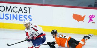 Washington Capitals' Alex Ovechkin (8) keeps the puck away from Philadelphia Flyers' Shayne Gostisbehere during the third period of an NHL game Sunday in Philadelphia.                                  AP photo