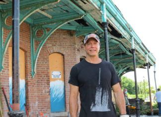 Developer George Albert stands outside the former Central Railroad of New Jersey train station in Wilkes-Barre last July as a community cleanup of the 1869 structure was getting underway.                                  Times Leader file photo