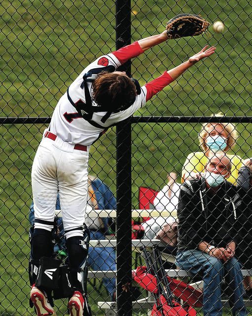 <p>Nanticoke Area catcher Ethan Egenski lunges for pop foul hit against the backstop fence by Lake-Lehman's Graedon Finarelli in the first inning Wednesday.</p>                                  <p>Fred Adams | For Times Leader</p>