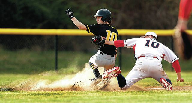 <p>Lake-Lehman's Ethan Leone beats the tag of Nanticoke Area third baseman Jake Krupinski in the fifth inning Wednesday. Leone went from first to third on an error.</p>                                  <p>Fred Adams | For Times Leader</p>