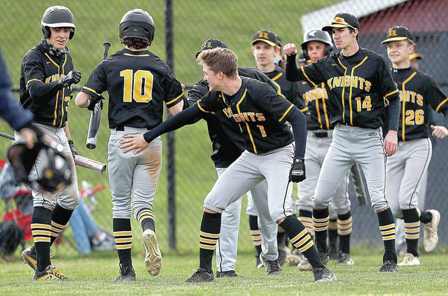 <p>Lake-Lehman's Ethan Leone is congratulated after scoring off a sacrifice fly by Nick Finarelli in the fifth inning Wednesday.</p>                                  <p>Fred Adams | For Times Leader</p>
