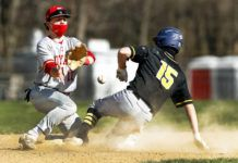 Lake-Lehman's Connor Morgan steals second base in the first inning Friday as as Holy Redeemer's Nick Dunleavy waits for the throw.                                  Fred Adams   For Times Leader