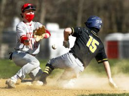 Lake-Lehman's Connor Morgan steals second base in the first inning Friday as as Holy Redeemer's Nick Dunleavy waits for the throw.                                  Fred Adams | For Times Leader