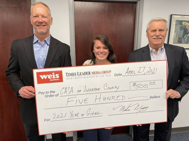 Mike Murray, right, publisher of the Times Leader Media Group, presents a $500 check to John Aciukewicz, left, executive director at the Court Appointed Special Advocates (CASA) of Luzerne County, and Brennan Morell, CASA program director. The check was presented as part of the Weis Markets/Times Leader Media Group Year of Giving program.                                  Bill O'Boyle | Times Leader