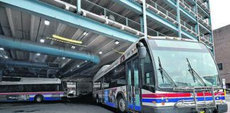 A Luzerne County Transportation Authority bus leaves the Wilkes-Barre intermodal center in this file photo. Passengers on LCTA buses and vans must start paying fares again on June 1, authority officials announced Tuesday.                                  Times Leader file photo