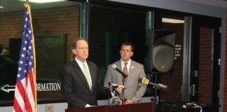 U.S. Sen. Pat Toomey, R-Lehigh Valley, left and Luzerne County District Attorney Sam Sanguedolce discuss the senator's 'Thin Blue Line Act' during a press conference at the Wilkes-Barre City Police Department headquarters Thursday. The legislation would make the murder of a federal law enforcement officer a factor for a jury to consider before imposing the death penalty. Toomey said he will reintroduce the bill next week.                                  Jerry Lynott   Times Leader
