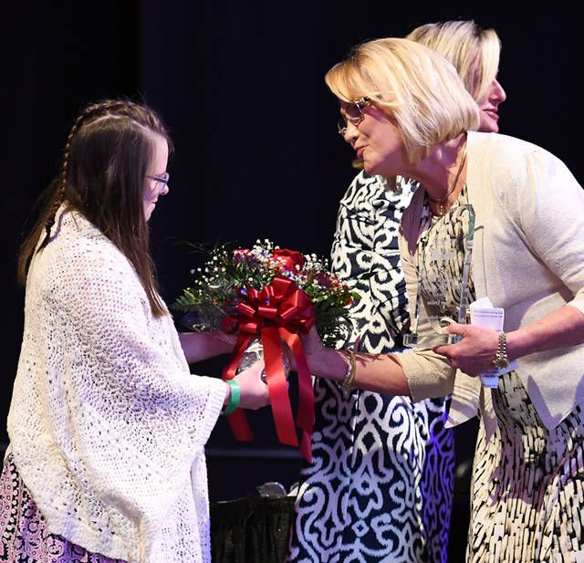 <p>Ellie Bartoli, left, hands Mary Erwine flowers, as one of the recipients of the Volunteer of the Year Award, Tuesday night at the Mohegan Sun Arena.</p>                                  <p>Tony Callaio | For Times Leader</p>