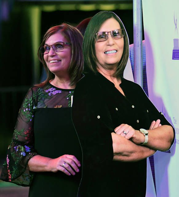 <p>You're not seeing double. That's Kathi Bankes, recipient of the ATHENA Award, poses with a cutout of herself at the Epic Awards, Tuesday night.</p>                                  <p>Tony Callaio | For Times Leader</p>