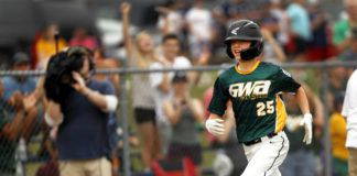 Greater Wyomimg Area's Luke Kopetchny rounds the bases after clubbing a grand slam in the first inning of the District 31 championship game on Monday night.                                  Fred Adams | Times Leader