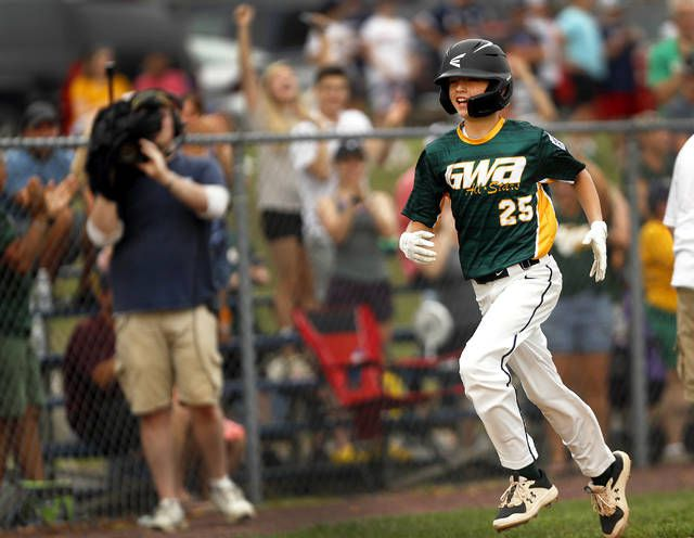 Greater Wyomimg Area's Luke Kopetchny rounds the bases after clubbing a grand slam in the first inning of the District 31 championship game on Monday night.                                  Fred Adams   Times Leader