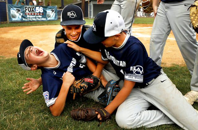 <p>Nick Bednar, Jimmy Youngblood and Brady Ecenrade celebrate Back Mountain National's 10-4 win over GWA in the District 31 championship game at the Duryea Little League Field on Monday night.</p>                                  <p>Fred Adams   Times Leader</p>