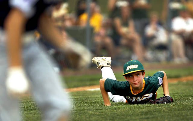 <p>GWA third bsaeman Zachary Smith watches Back Mountain National's Chris Flanagan run to first base after making a dive for the ball.</p>                                  <p>Fred Adams   Times Leader</p>