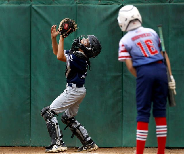 <p>Back Mountain National catcher Jimmy Youngblood gets under a foul ball hit by GPA's Nick Innamorati in the second inning Sunday.</p>                                  <p>Fred Adams | For Times Leader</p>
