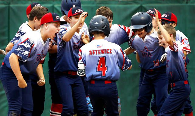 <p>Ethan Aftewicz is greeted by his GPA teammates after hitting a two-run homer in the fourth inning of Sunday's Section 5 Little League major baseball winners bracket final. Aftewicz hit a three-run homer in the fifth and finished with seven RBI.</p>                                  <p>Fred Adams | For Times Leader</p>