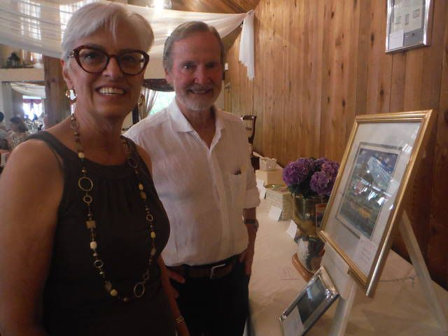 <p>Connie and Durelle Scott of Dallas look over some of the auction items that were on display at Apple Tree Terrace at Newberry Estates, where the Back Mountain Memorial Library Auction's kick-off dinner was held Monday evening.</p>                                  <p>Mary Therese Biebel   Times Leader</p>