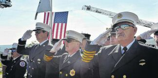 Nanticoke Fire and Police personnel stand at attention during the National Anthem during a September 11 ceremony at Luzerne County Community College in 2017. Several commemorations are set for tomorrow, Friday, Sept. 10, in advance of the 20th anniversary of the 9/11 attacks, which falls on Saturday.                                   Times Leader file photo