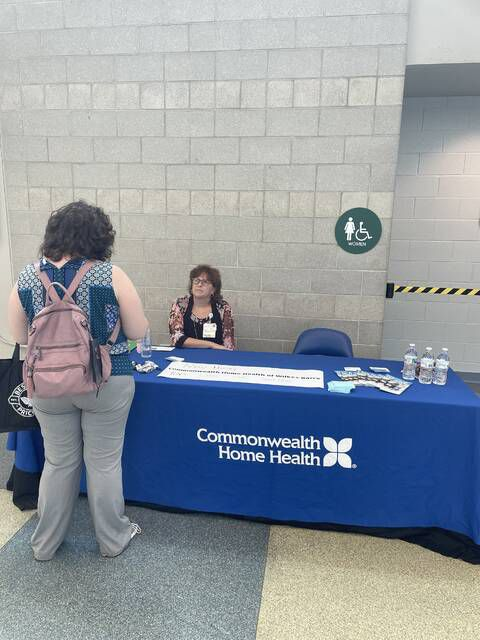 <p>Job seekers stop at a vendor's table to discuss what positions are available at the Times Leader Career Fair Wednesday at Mohegan Sun Arena.</p>                                  <p>Times Leader photo</p>