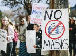 Demonstrators gather outside Flathead High School to protest the Kalispell School District's face mask requirement on March 9, 2021, in Kalispell, Mont. Here in Pennsylvania, thousands of students have requested to go mask-free in school, claiming a medical exemption amid fierce local opposition to the state's new face-covering mandate.