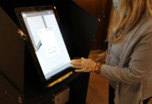 One of Luzerne County's electronic voting machines is seen being demonstrated last fall in this file photo. County officials have vowed to do their best to pull off a problem-free election next month by methodically staying on top of preparations.                                  Times Leader file photo