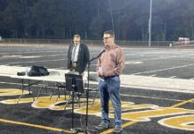 Jamie Walsh opened Tuesday's mask mandate discussion at the Lake-Lehman football field with some remarks, saying that 'we all could agree or disagree on things, but I know we all love our children and grandchildren.' Guest speaker Eric Winter, an attorney from Berks County, is behind him.                                  Kevin Carroll   Times Leader